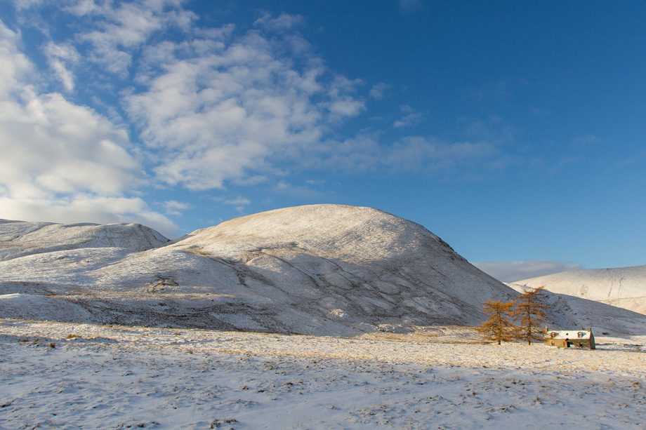 Derelict barn and mountain scenery in winter, Highlands, Scotland, UK