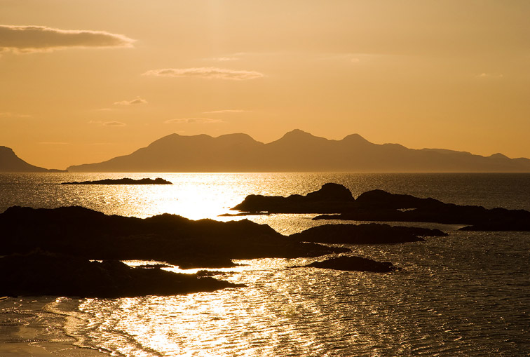 Isle of Rum at sunset viewed from Arisaig, north-west Highlands, Scotland, March 2008