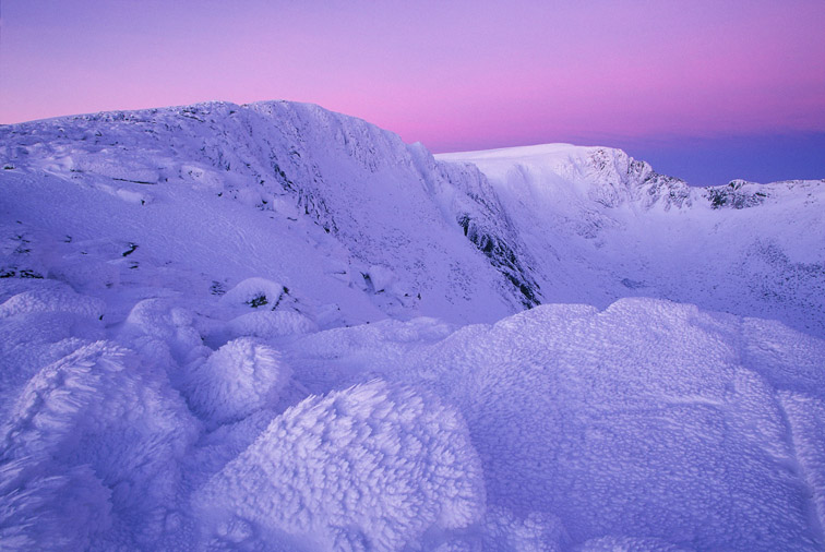 Ice-sculpted rocks at dawn, Northern Corries, Grampian Mountains. Cairngorms National Park. Scotland. March.