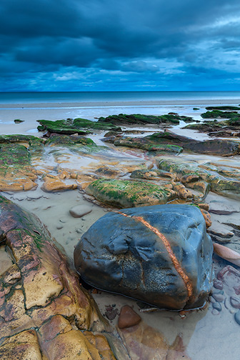 Rock on foreshore of beach, Moray, Scotland