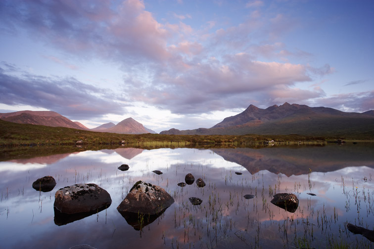 The Cuillin & Marsco reflected in moorland pool at sunset. Isle of Skye. Scotland. June 2007.