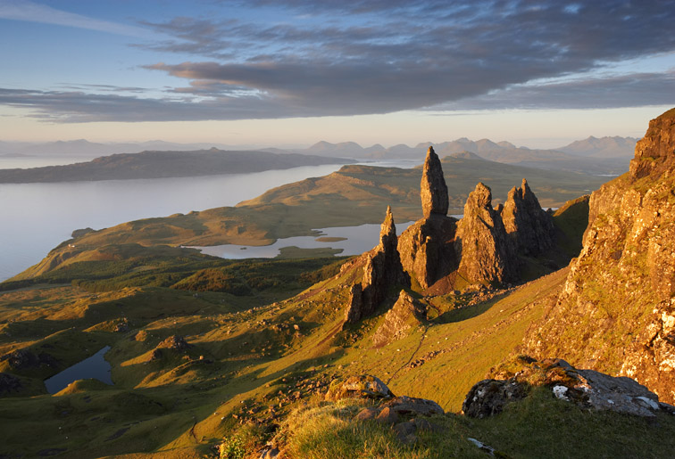 Old Man of Storr with Isle of Raasay and Cuillin mountains beyond. Isle of Skye. Scotland. June.