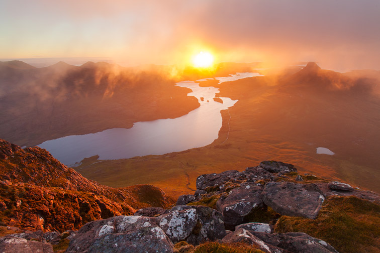 View from summit of Cul Beag overlooking Loch Lurgainn and Stac Pollaidh at sunset, Coigach, Scotland