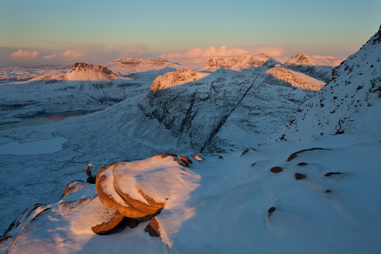 View from Sgurr an Fhidhleir (705m) towards Stac Pollaidh at sunset, Coigach, Wester Ross, North-west Scotland, December